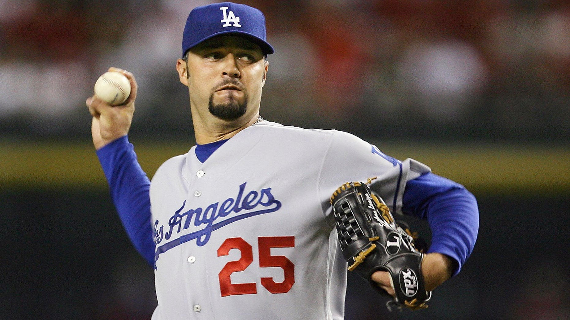 FILE Sept. 21, 2007: Los Angeles Dodgers' Esteban Loaiza, of Mexico, throws a pitch against the Arizona Diamondbacks in the first inning of a baseball game in Phoenix. Former All-Star pitcher Loaiza - who earned a total of more than $43 million over 14 seasons - is heading to court accused of drug dealing involving 20 kilograms (44 pounds) of suspected cocaine. The 46-year-old retired Major League Baseball player is scheduled to appear in court in Chula Vista, Calif., south of San Diego, on Wednesday, Feb. 14, 2018.