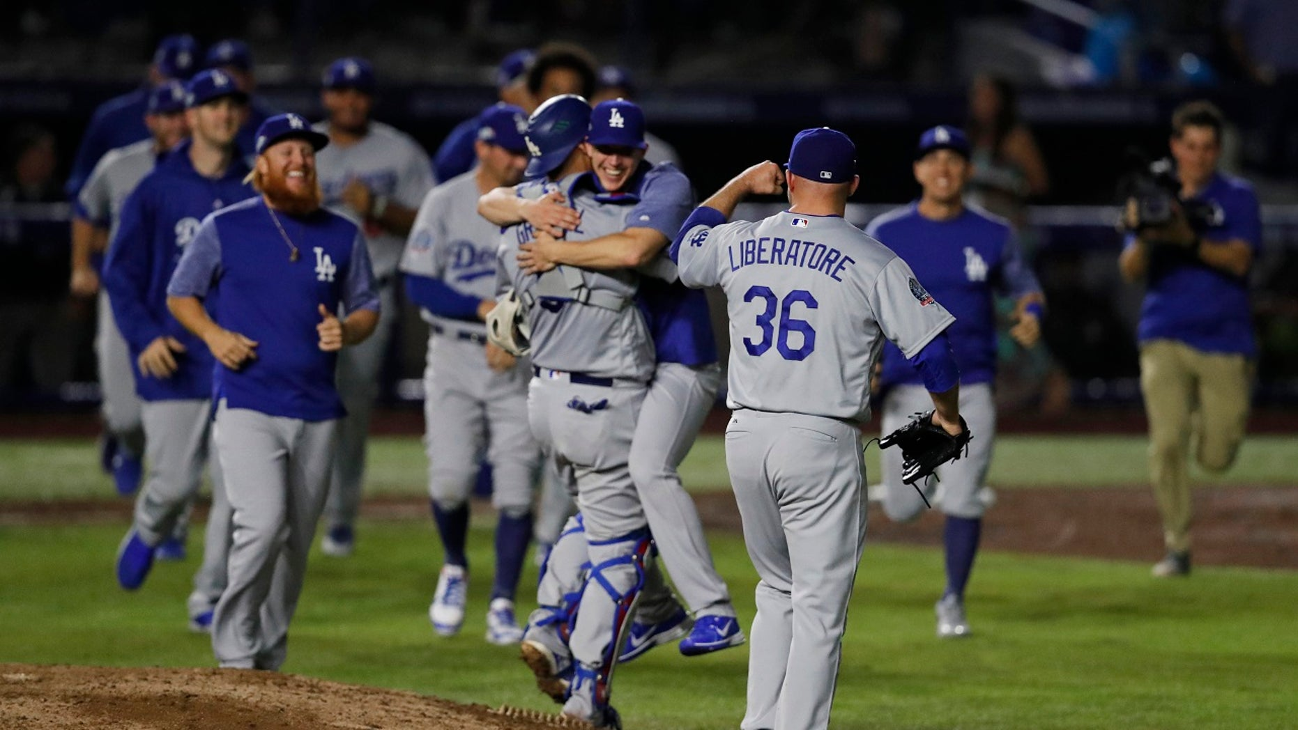 The Los Angeles Dodgers celebrate their 4-0 victory over the San Diego Padres, the first MLB no-hitter in Mexico, May 4, 2018.