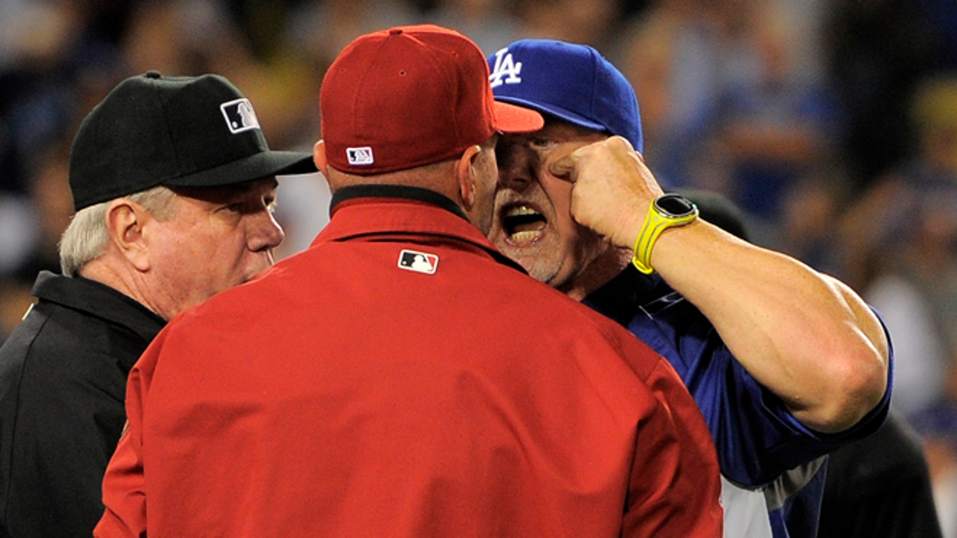 June 11, 2013: Los Angeles Dodgers batting coach Mark McGwire, right, yells at Arizona Diamondbacks manager Kirk Gibson after Los Angeles Dodgers' Zack Greinke was hit by a pitch during the seventh inning of their baseball game in Los Angeles.  (AP/Mark J. Terrill)