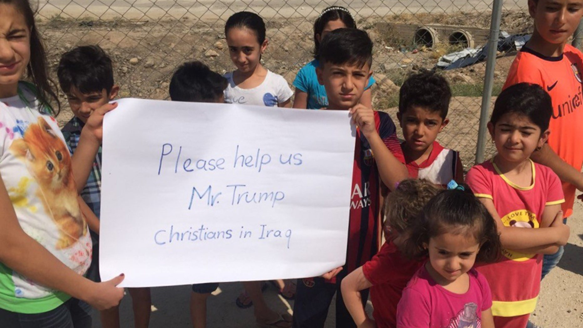 Images provided to Fox News show Christian Iraqi children pleading for help from the US, which experts say underscores the plight faced by the country's religious minorities.