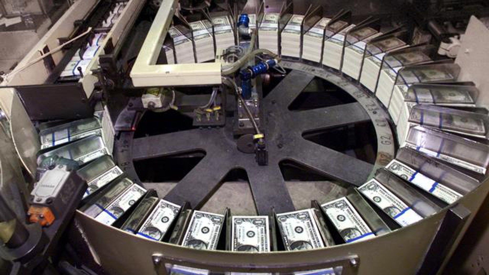 Stacks of dollar bills are readied for shipment at the U.S. Bureau of Engraving and Printing in Washington, D.C.
