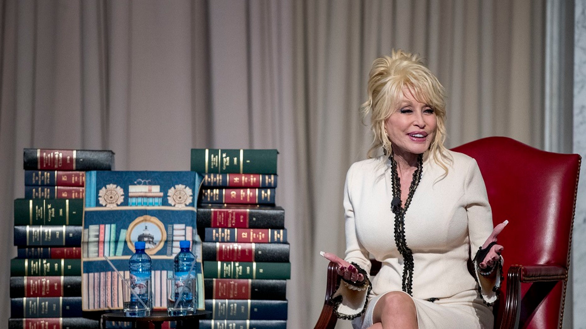Legendary country singer Dolly Parton donated her 100 millionth book to the Library of Congress Tuesday, Feb. 27, 2018.