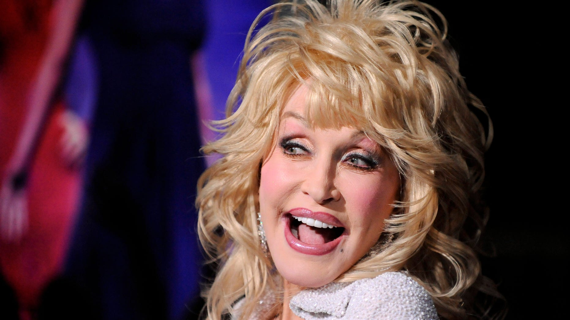 """January 9, 2012. Dolly Parton arrives at the Hollywood premiere of  """"Joyful Noise"""" in Los Angeles, California."""