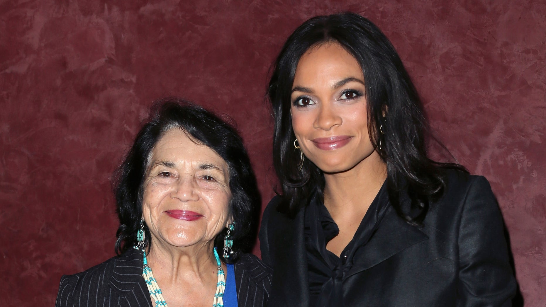 """LOS ANGELES, CA - MARCH 28:  Labor leader and civil rights activist Dolores Huerta (L) and actress Rosario Dawson, who plays Huerta in the film, attend a screening of """"Cesar Chavez"""" at Landmark Theatres on March 28, 2014 in Los Angeles, California.  (Photo by David Livingston/Getty Images)"""