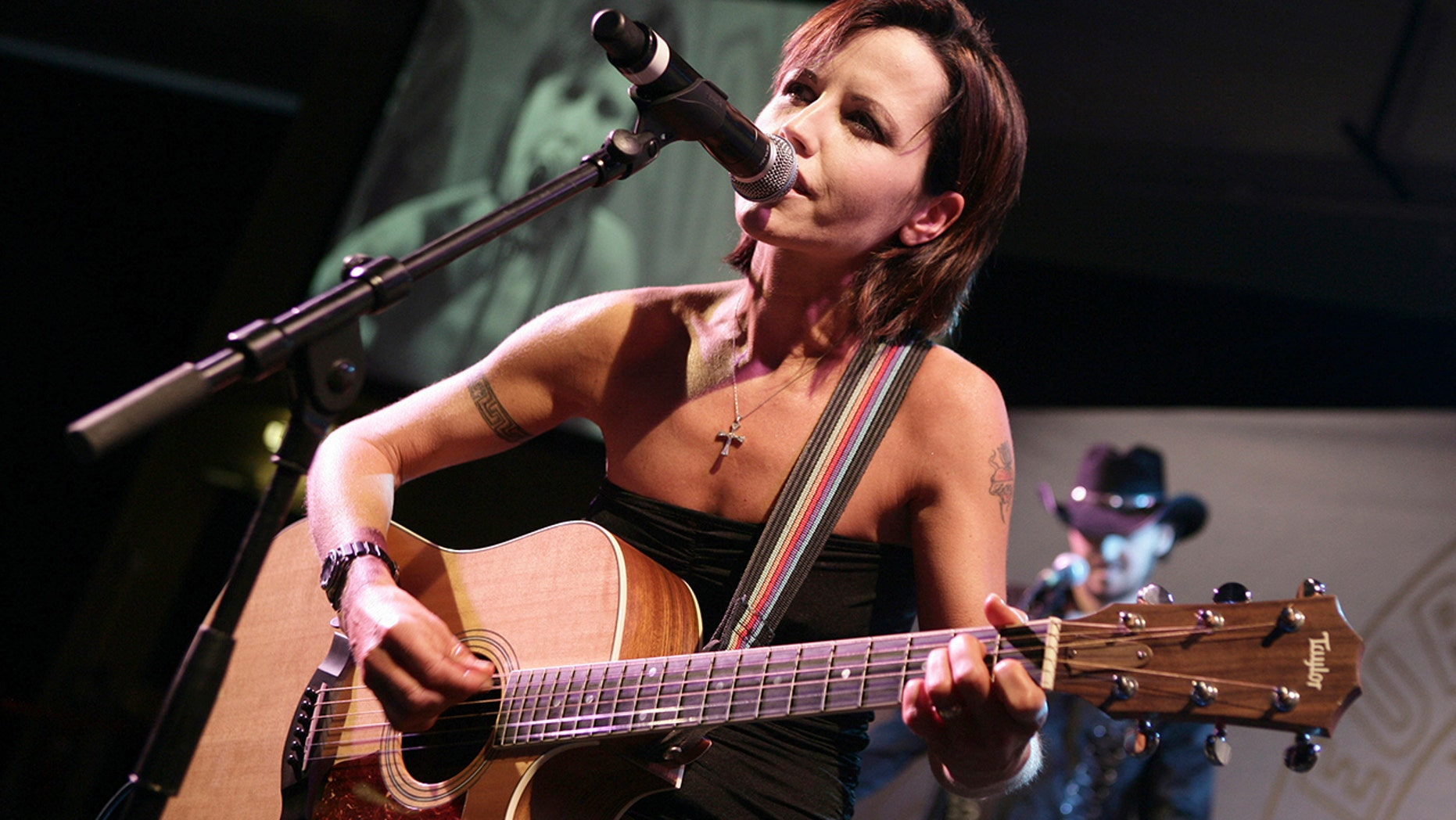 "Beside Dolores O'Riordan's casket was a bouquet of flowers inscribed with lyrics from the band's hit ""Linger"" that read, ""The song has ended, but the memories linger on."""