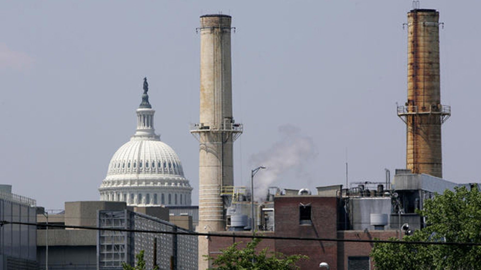 Coal-fired power plants are seen with the U.S. Capitol looming in the background.
