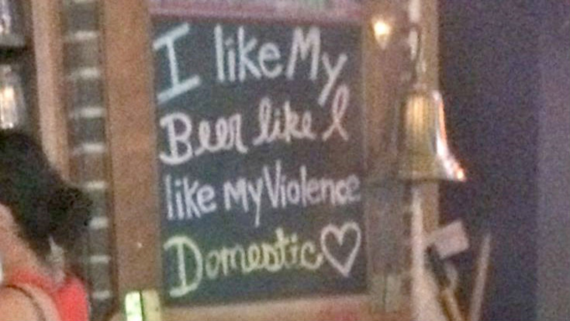 """Patrol Courtney Williams was at Scruffy Duffies when she noticed a sign that read, """"I like my beer how I like my violence...Domestic."""""""