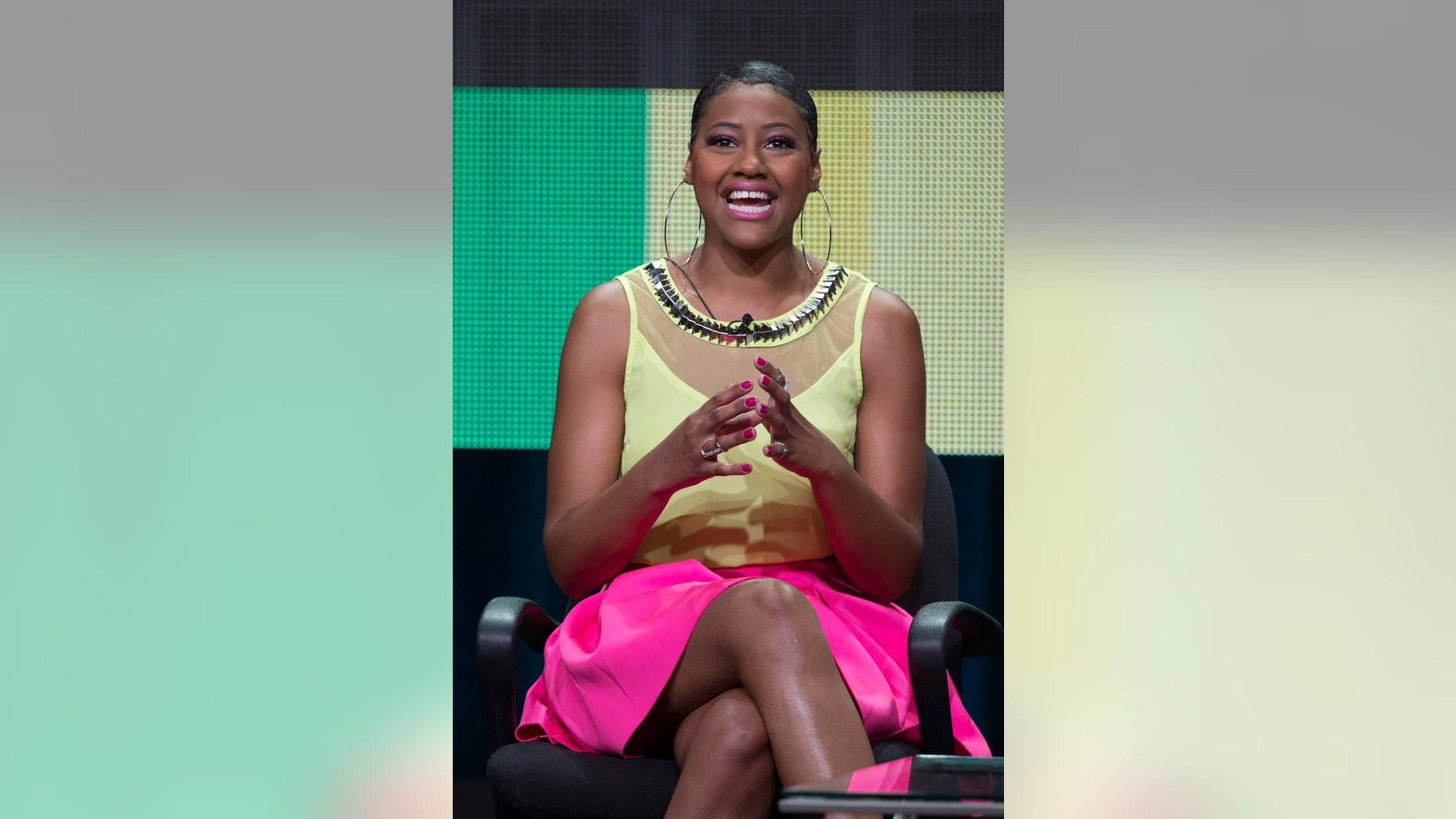 """July 11, 2014. Dominique Sullivan speaks at a panel for the MTV television series """"Virgin Territory"""" during the Television Critics Association Cable Summer Press Tour in Beverly Hills, California."""