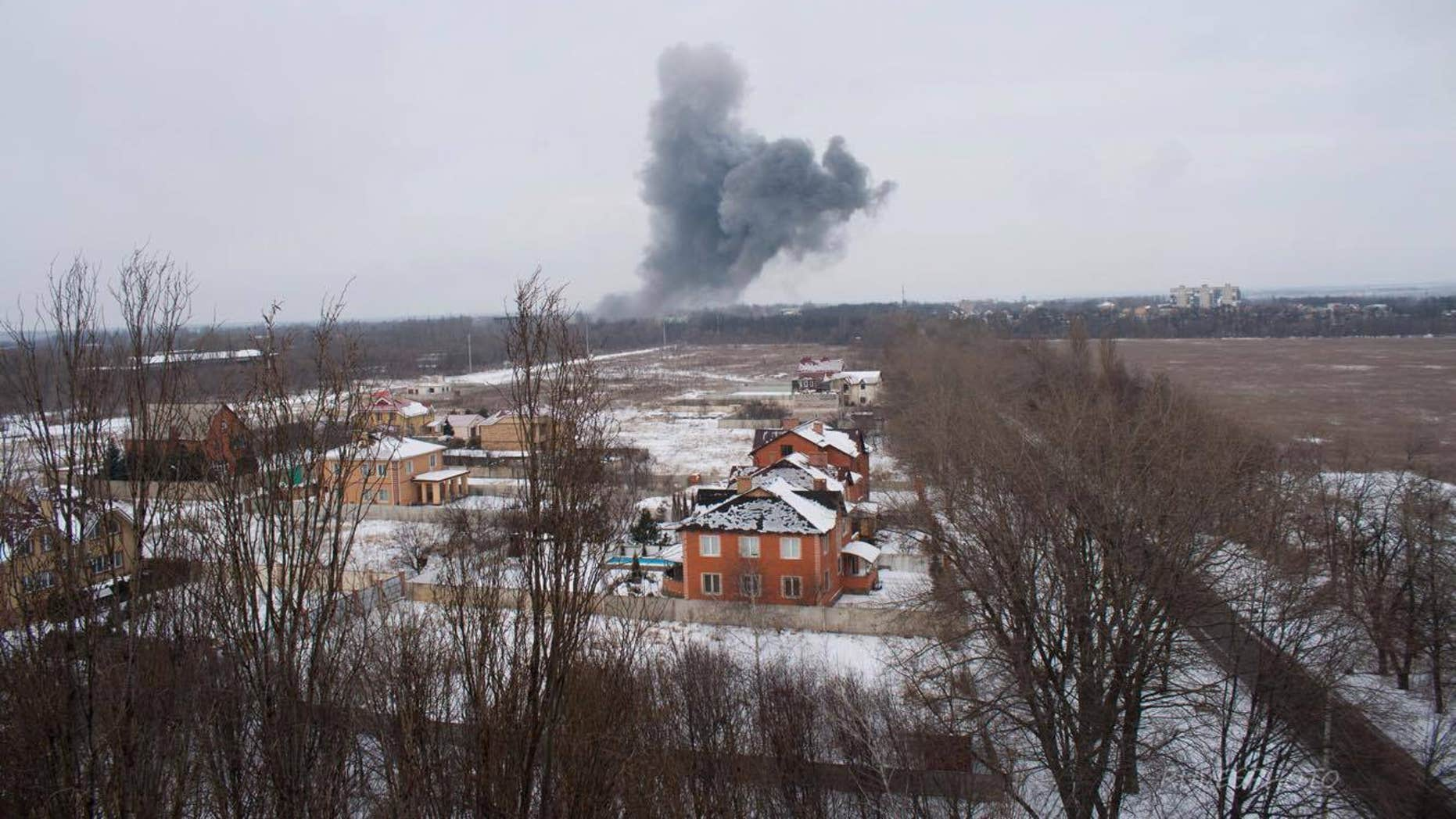 Artillery shells hit industrial areas in Donetsk as the conflict enters its third year.
