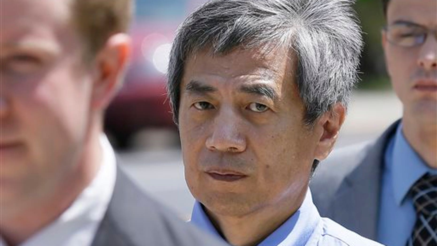 FILE - In this July 1, 2014 file photo, former Iowa State University researcher Dong-Pyou Han leaves the federal courthouse in Des Moines, Iowa. (AP Photo/Charlie Neibergall, File)