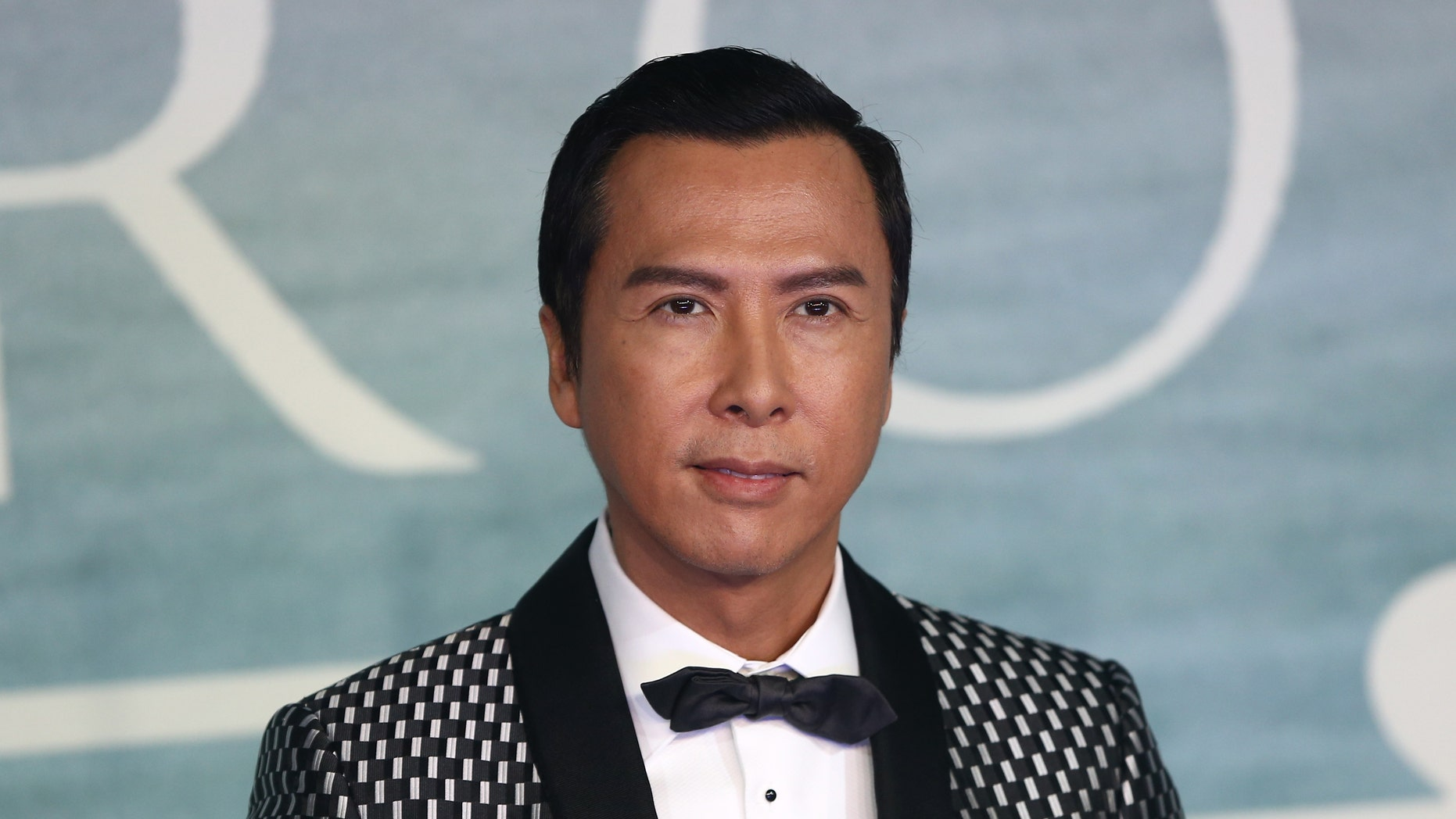 Donnie Yen arrives at the European Premiere of Star Wars Rogue One at the Tate Modern in London, Britain December 13, 2016. REUTERS/Neil Hall  - RTX2UW0U