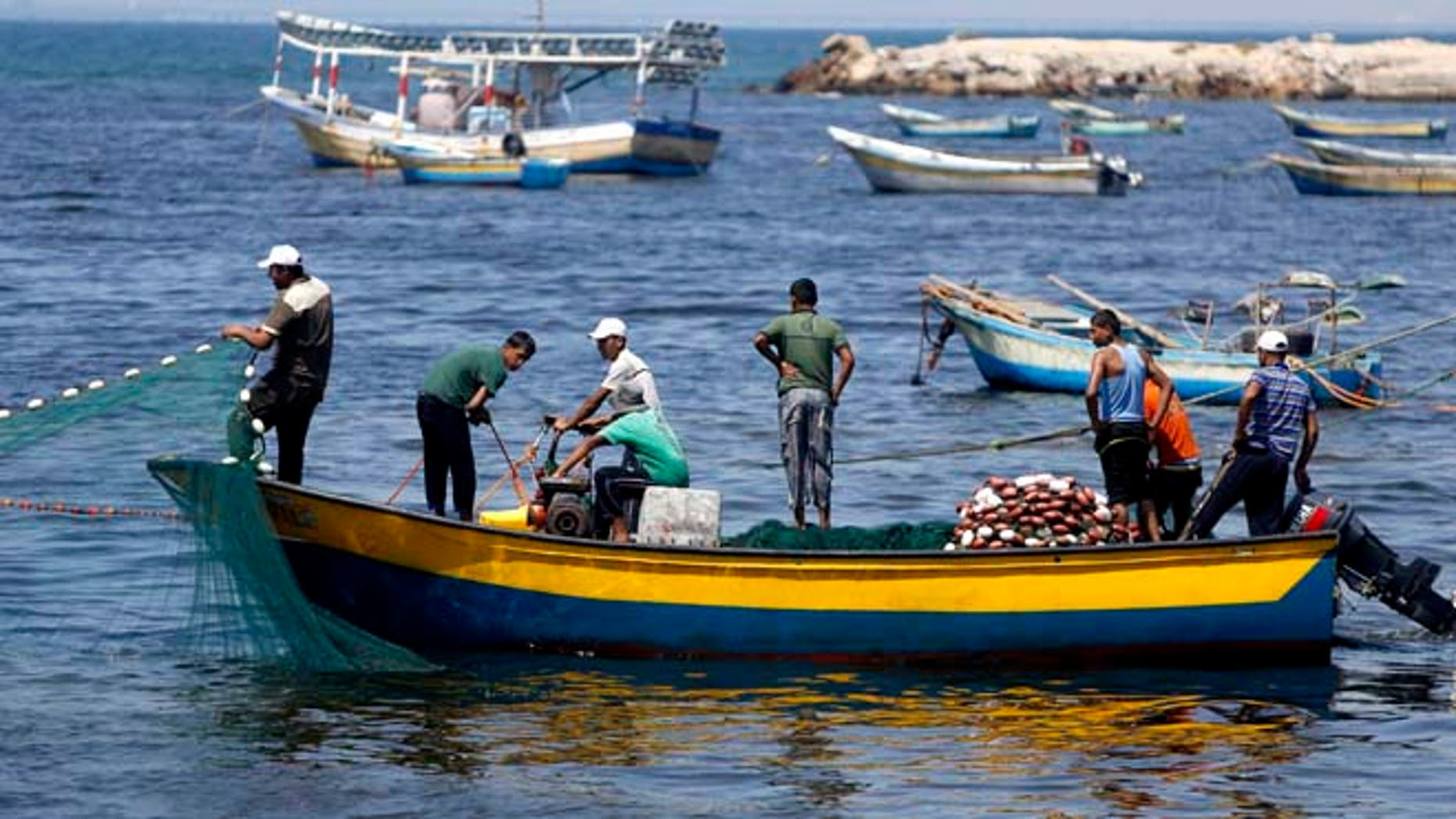 Aug. 7, 2014: In this file photo, Palestinian fishermen clean their fishnets at the fishermen's port in Gaza City. (AP)