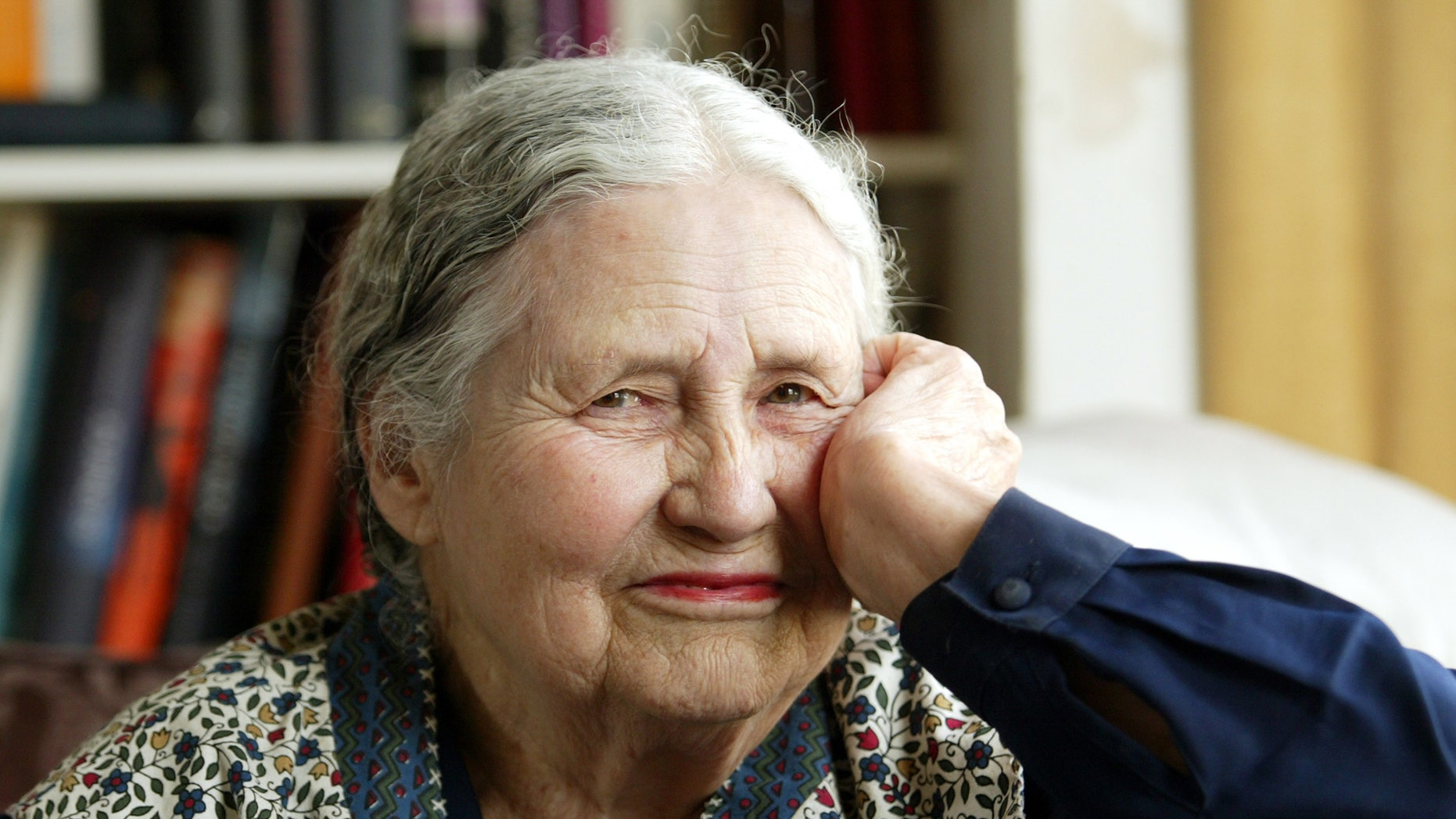 """In this April 17, 2006 file photo, Writer Doris Lessing, 86, sits in her home in north London. Lessing, the free-thinking, world-traveling, often-polarizing writer of """"The Golden Notebook"""" and dozens of other novels that reflected her own improbable journey across the former British empire, has died, early Sunday, Nov. 17, 2013. She was 94."""
