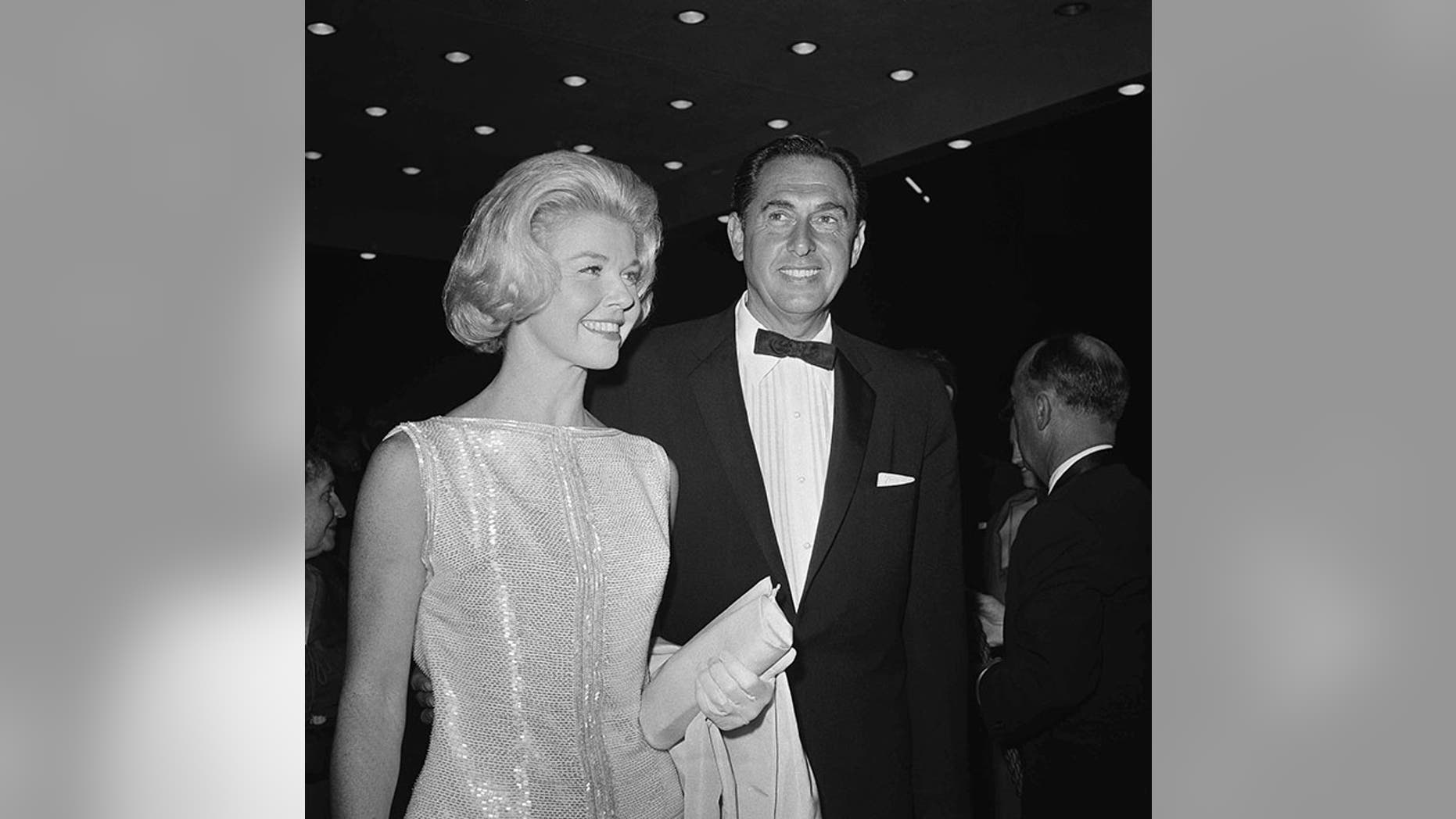 Doris Day and then-husband Marty Melcher arrive at the 1960 Academy Awards at the Pantages Theater in Los Angeles.