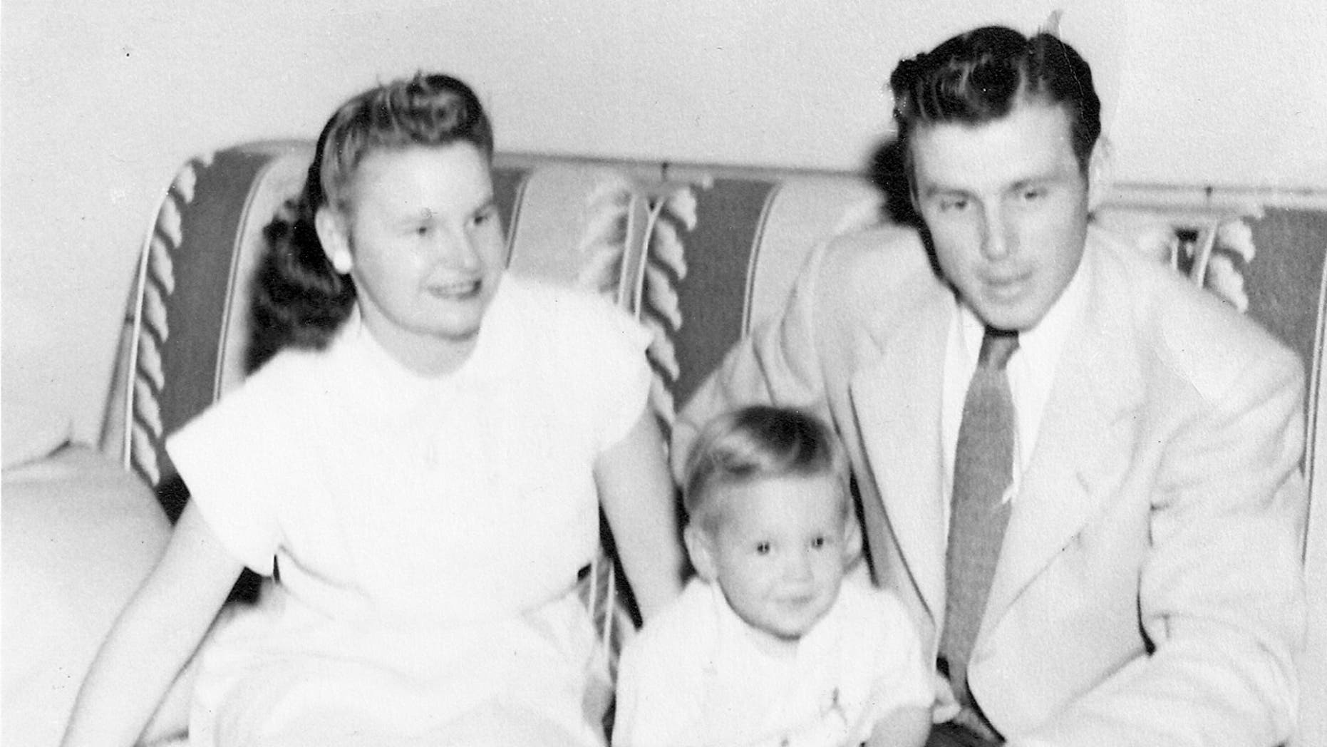 A photo of Hal Downes (R) with his wife, Elinor Lee (L) and young son, Richard (C).