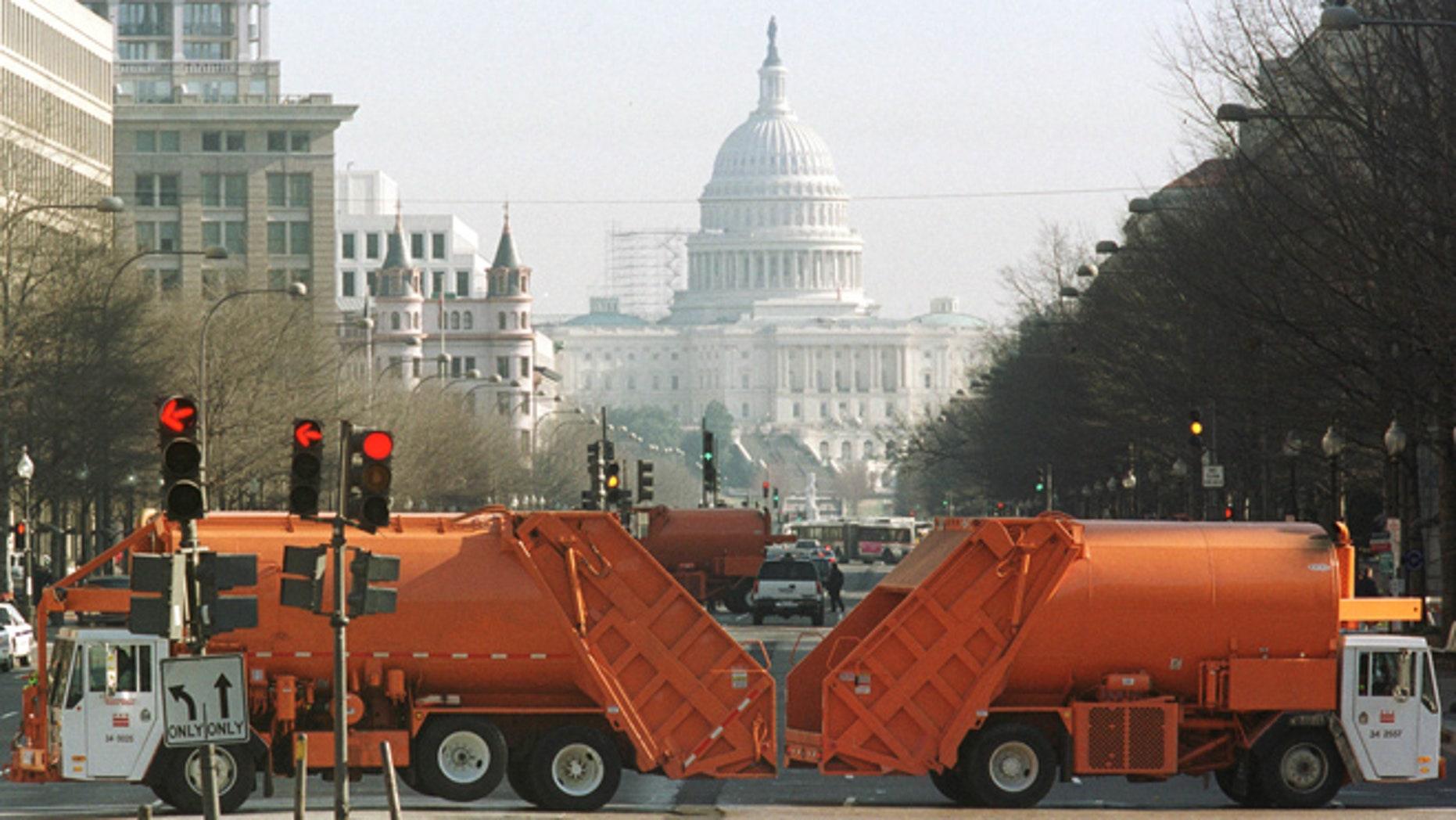 FILE: Washington, D.C. municipal garbage trucks are seen on Pennsylvania Avenue.