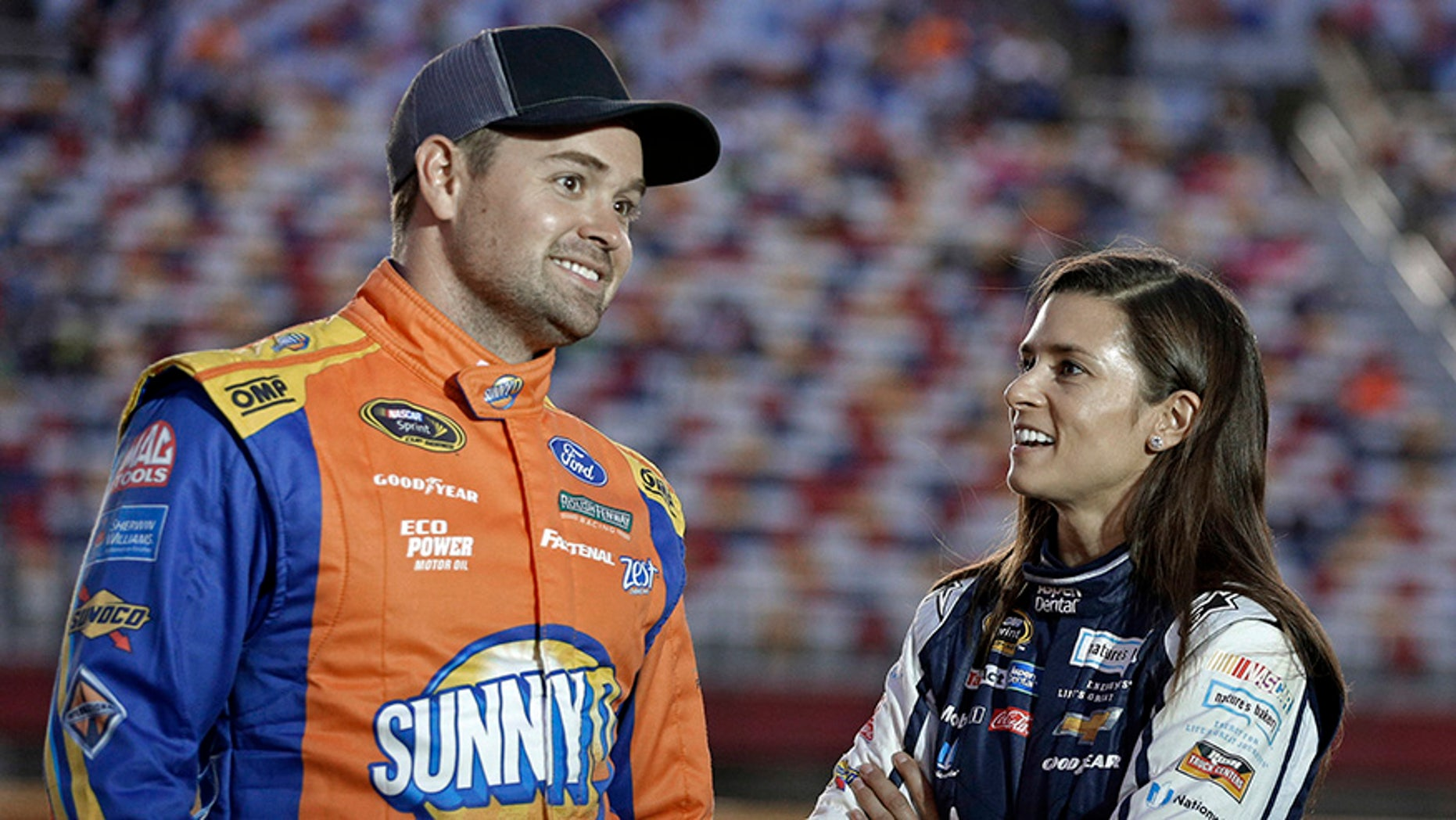 """FILE - In this Oct. 6, 2016, file photo, Danica Patrick, right, talks with Ricky Stenhouse Jr, before qualifying for Saturday's NASCAR Sprint Cup series auto race at Charlotte Motor Speedway in Charlotte, N.C. Danica Patrick and Ricky Stenhouse Jr. have ended their nearly five-year relationship. A spokeswoman for Patrick confirmed to The Associated Press on Monday, Dec. 18, 2017,  that the race car drivers """"are no longer in a relationship."""" (AP Photo/Chuck Burton, File)"""
