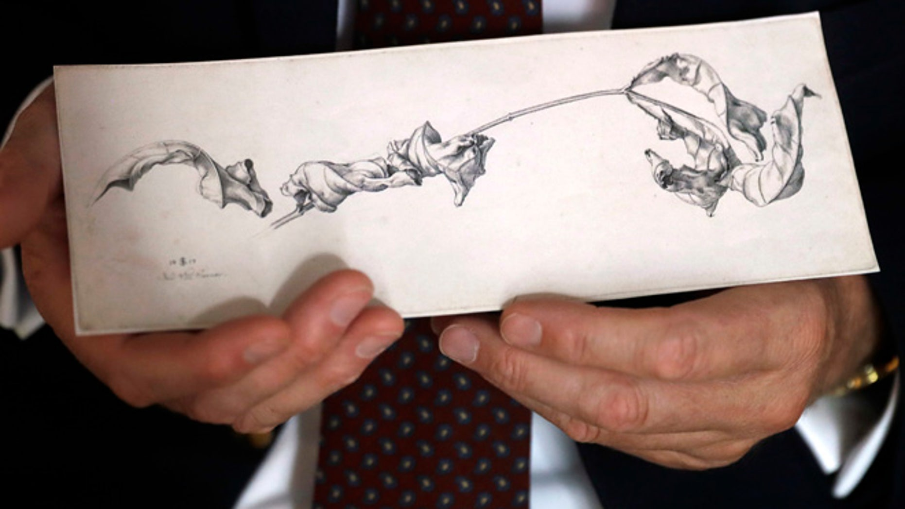 Dr. Johann Schiller holds a replica of a nearly 200-year-old drawing, Wednesday, Aug. 17, 2016, in Washington, after the original was returned to his family from the National Gallery of Art's collection decades after his relative was forced to sell it during World War II because of her Jewish heritage. (AP Photo/Jacquelyn Martin)