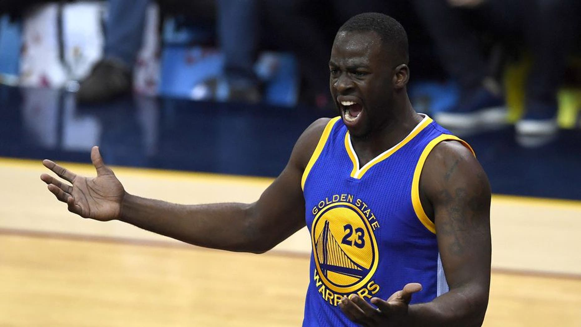 CLEVELAND, OH - JUNE 16: Draymond Green #23 of the Golden State Warriors reacts after a play in the second half against the Cleveland Cavaliers in Game 6 of the 2016 NBA Finals at Quicken Loans Arena on June 16, 2016 in Cleveland, Ohio. NOTE TO USER: User expressly acknowledges and agrees that, by downloading and or using this photograph, User is consenting to the terms and conditions of the Getty Images License Agreement. (Photo by Jason Miller/Getty Images)