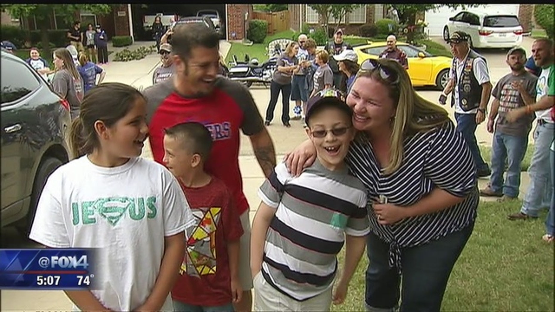 Bryce Aswell, center, arrives at his home to see his new room with his family.