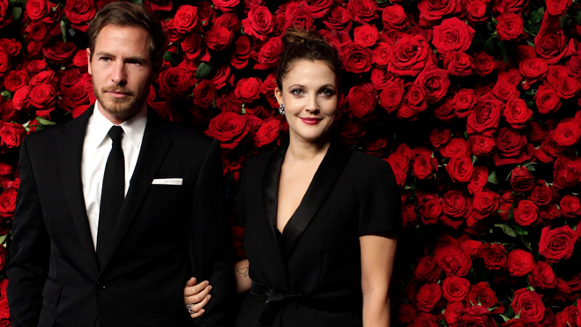 November 15, 2011. Actress Drew Barrymore (R) and Will Kopelman (L) attend the Museum of Modern Art's fourth annual Film Benefit in New York.