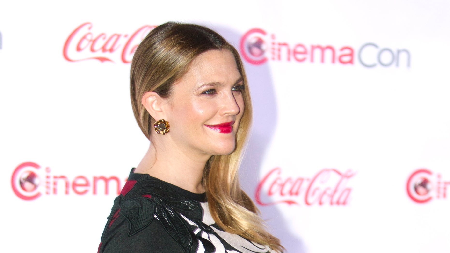 March 27, 2014. A pregnant Drew Barrymore poses as she arrives for the Big Screen Achievement Awards during CinemaCon, the official convention of the National Association of Theatre Owners, at Caesars Palace in Las Vegas, Nevada.
