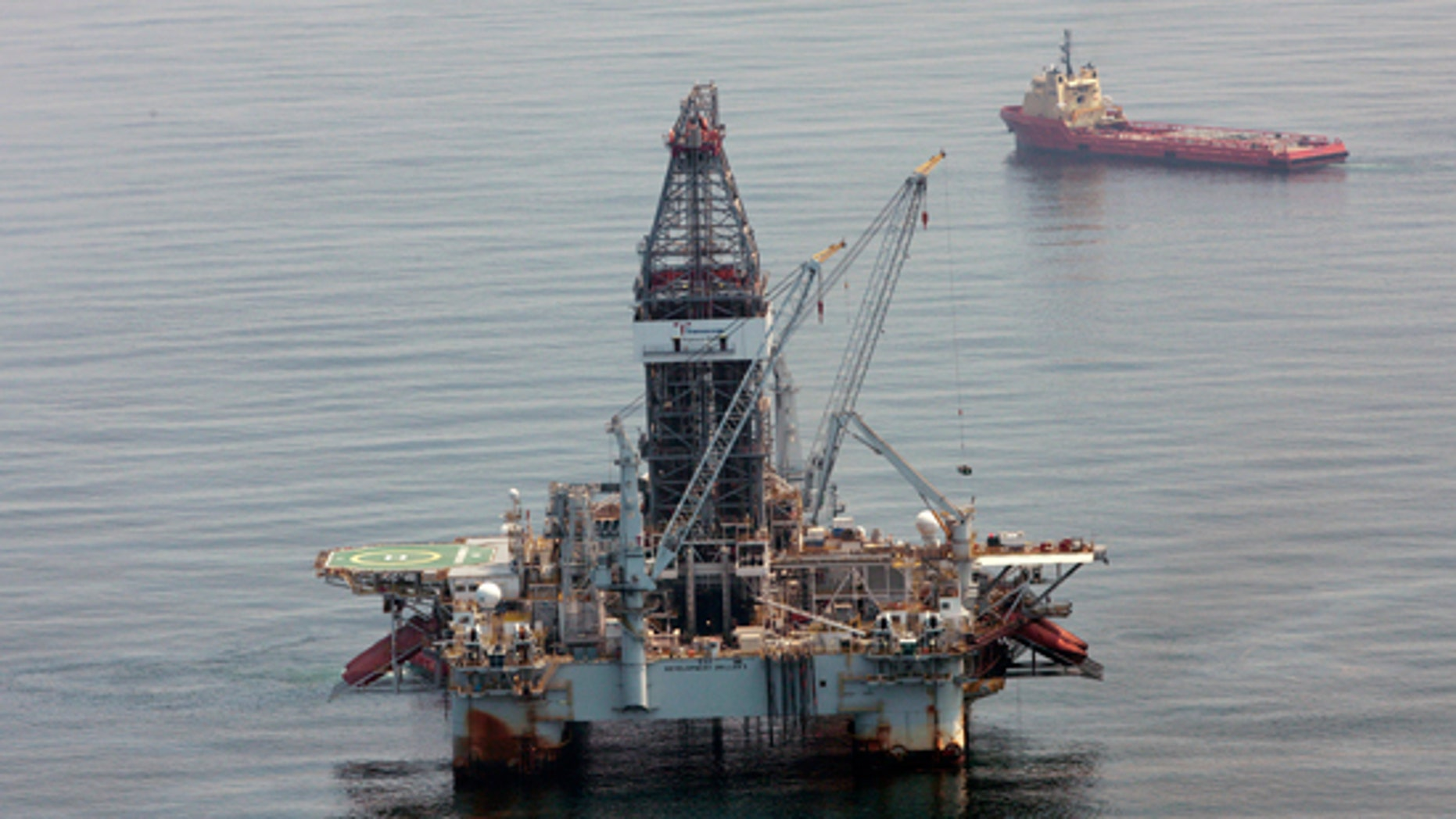 In a Tuesday, June 8, 2010 photo, a deepwater drilling rig operates near the site of the Deepwater Horizon disaster in the Gulf of Mexico. (AP)