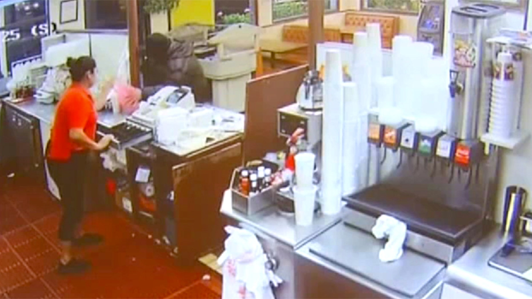 A robbery suspect was shot twice by another customer early Saturday morning.