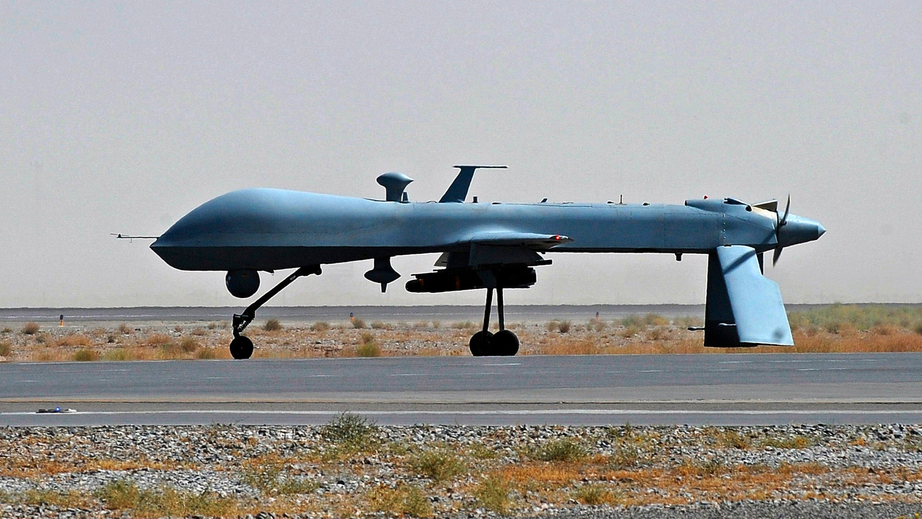 June 13, 2010: U.S. Predator unmanned drone armed with a missile stands on the tarmac of Kandahar military airport in Afghanistan.