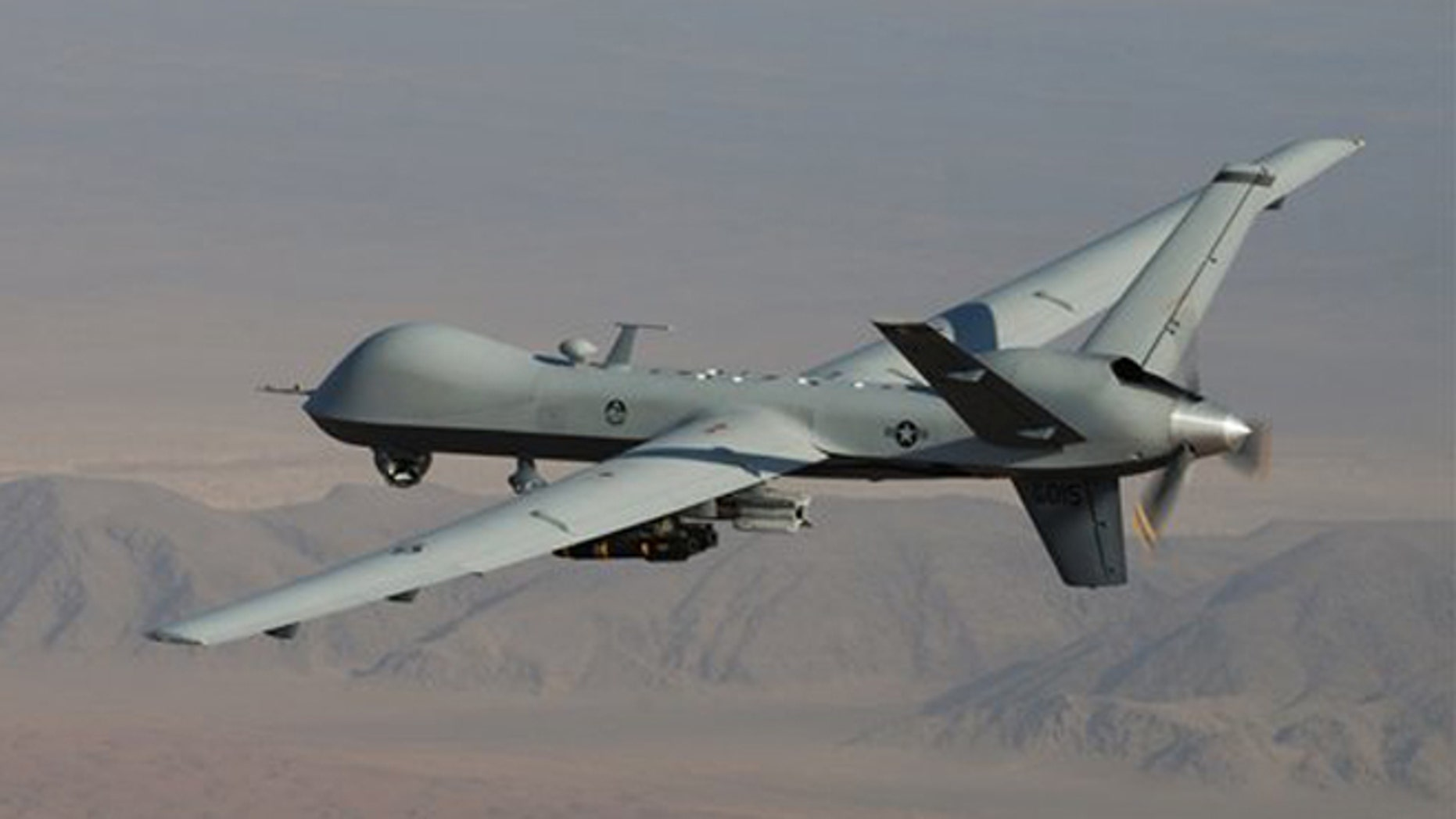 A MQ-9 Reaper, armed with GBU-12 Paveway II laser guided munitions and AGM-114 Hellfire missiles, is piloted by Col. Lex Turner during a combat mission over southern Afghanistan.