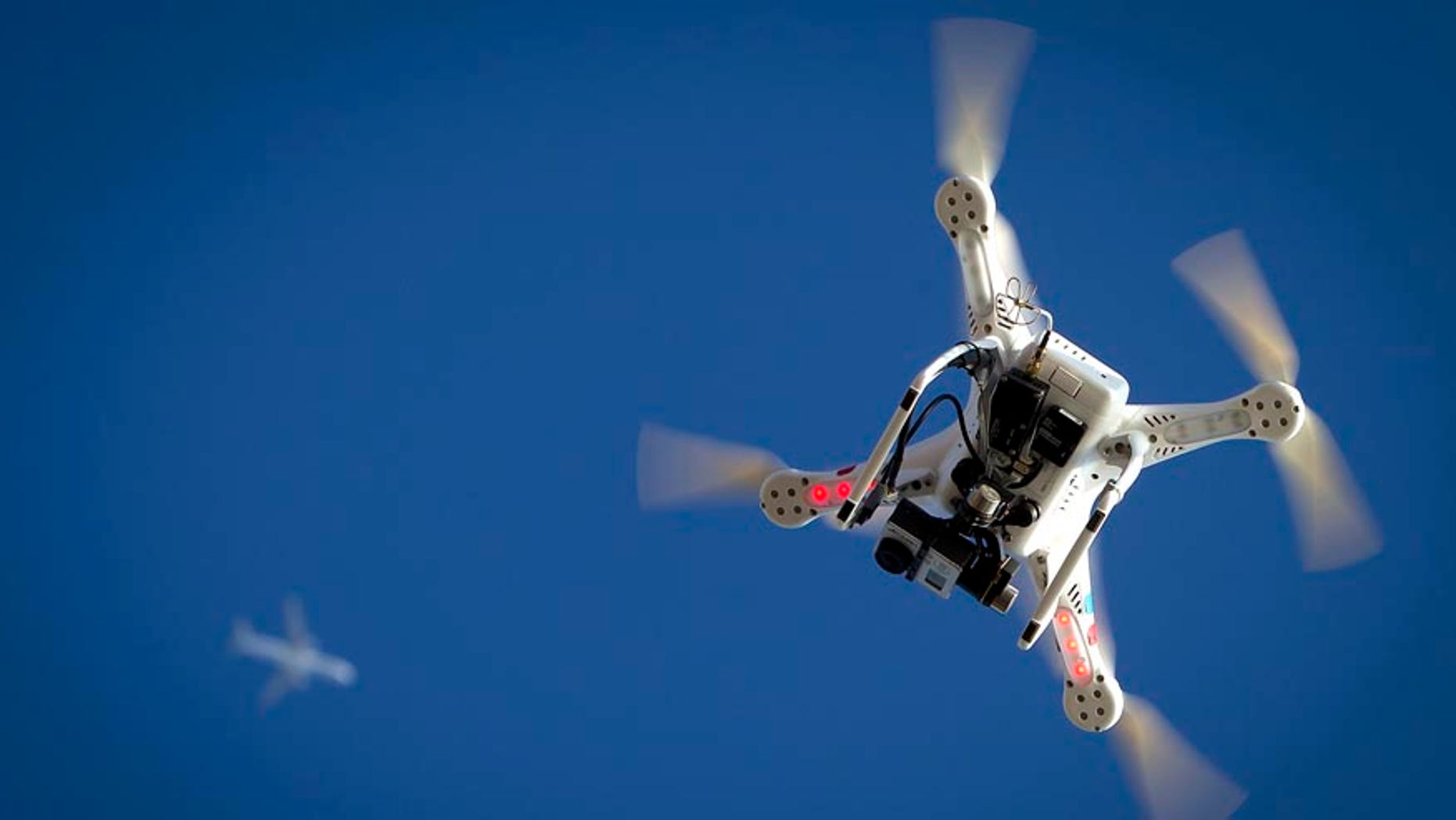 File photo. An airplane flies over a drone during the Polar Bear Plunge on Coney Island in the Brooklyn borough of New York January 1, 2015.