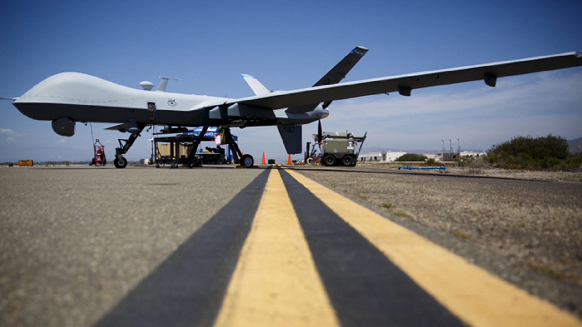"""July 31, 2015: A General Atomics MQ-9 Reaper stands on the runway during """"Black Dart"""", a live-fly, live fire demonstration of 55 unmanned aerial vehicles, or drones, at Naval Base Ventura County Sea Range, Point Mugu, near Oxnard, California. (Reuters)"""