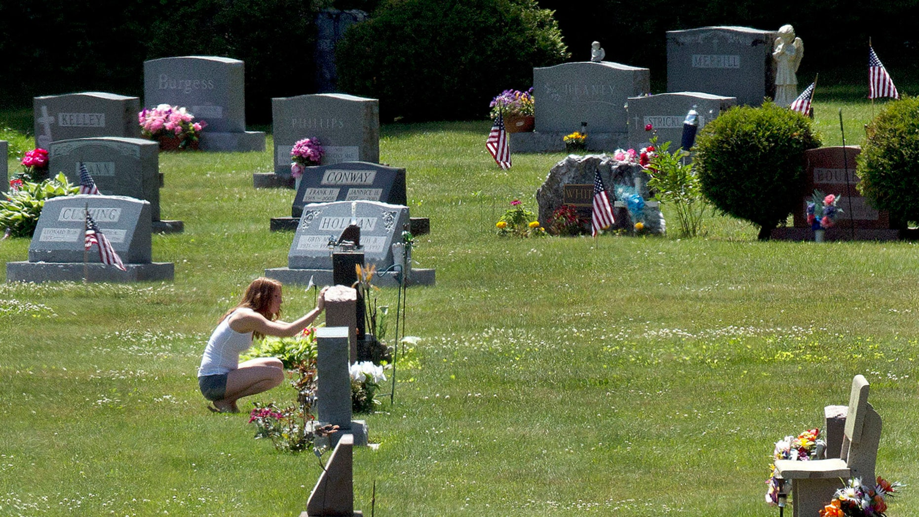 FILE - In this June 17, 2016 file photo, Erika Marble visits the gravesite of Edward Martin III, her fiancé and father of her two children, in Littleton, N.H.