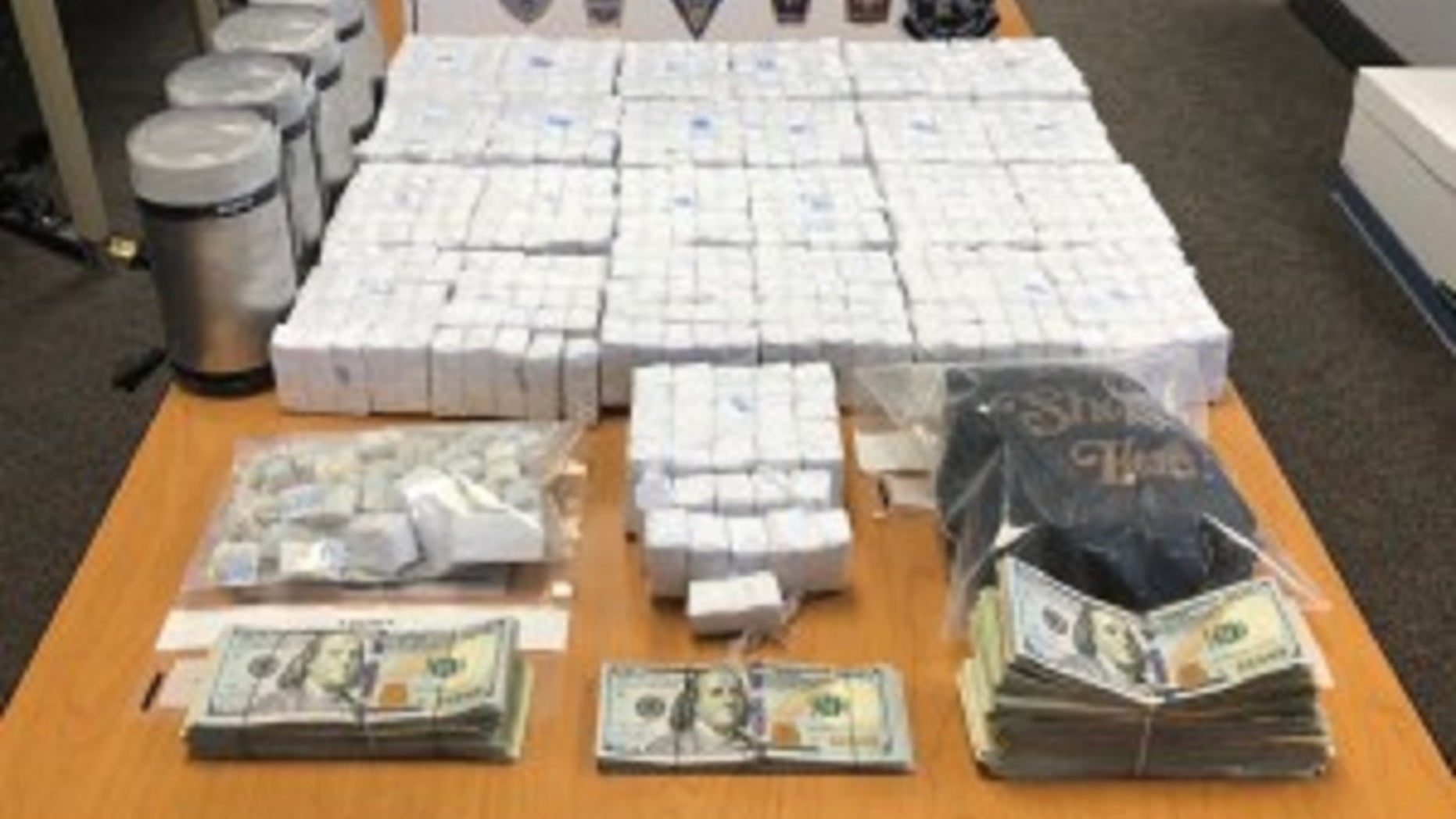Over $250,000 and approximately 50,000 bags of heroin were seized in a series of raids conducted this week by Massachusetts State Police.
