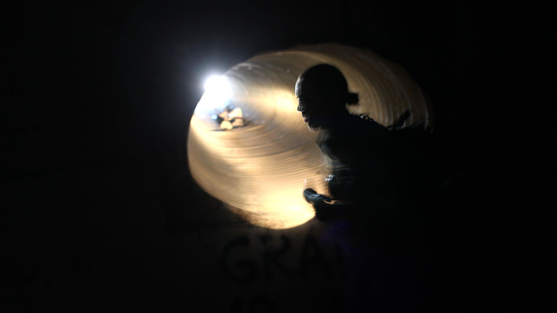 (FILE PHOTO) U.S. Border Patrol agent Colleen Agle searches for evidence of drug smugglers in a drainage tunnel that runs under the U.S.- Mexico border on December 7, 2010 in Nogales, Arizona.  (Photo by John Moore/Getty Images)