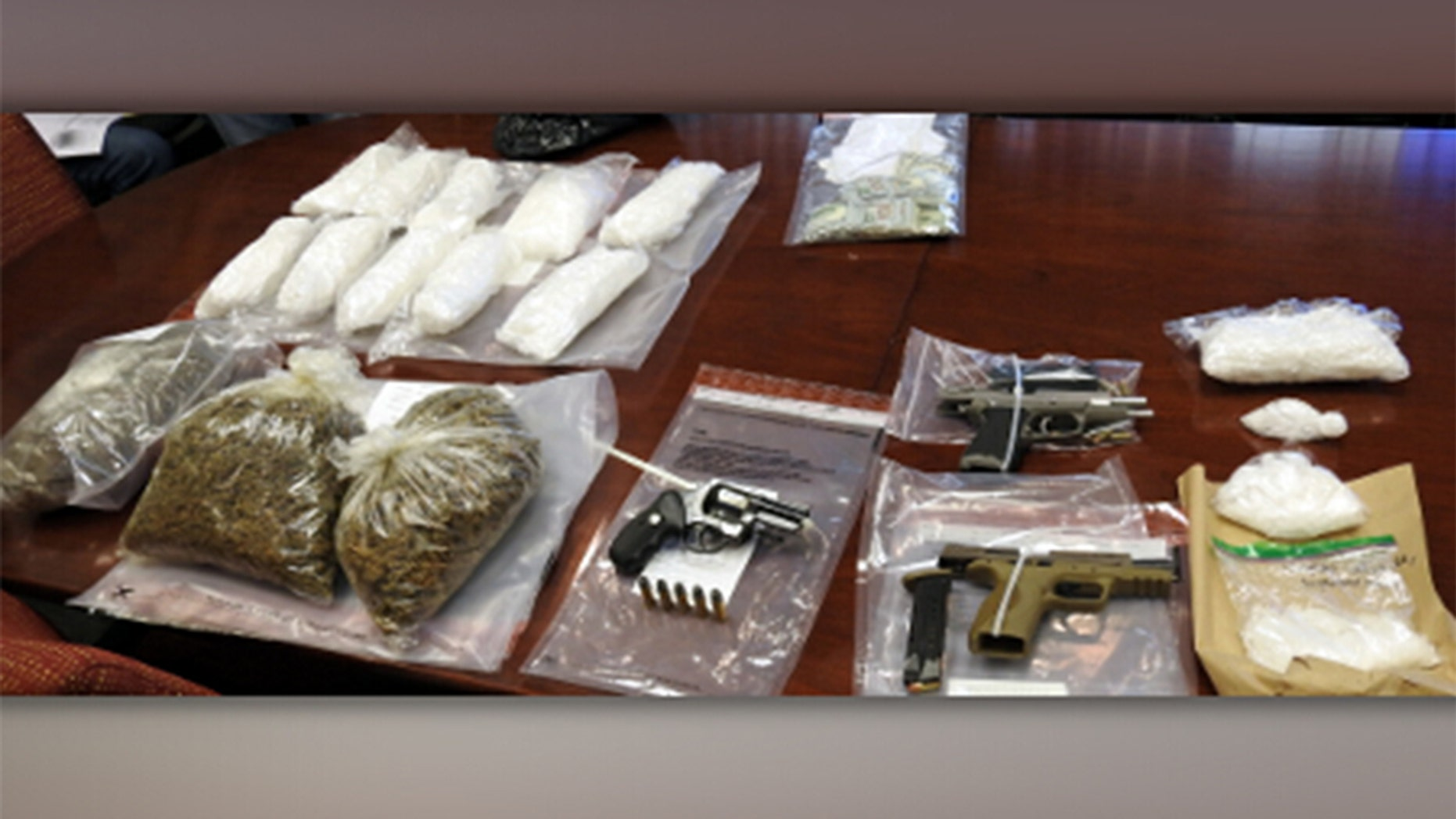 "Authorities said they seized 46 pounds of methamphetamine, three pounds of processed marijuana, $10,000 in cash, five guns and 211 marijuana plants were ""eradicated"" following a California drug bust."