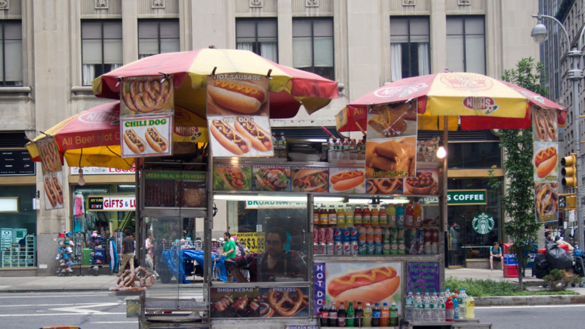 New York City hot dog vendors are visible on nearly every street corner of neighborhoods with popular tourist attractions.