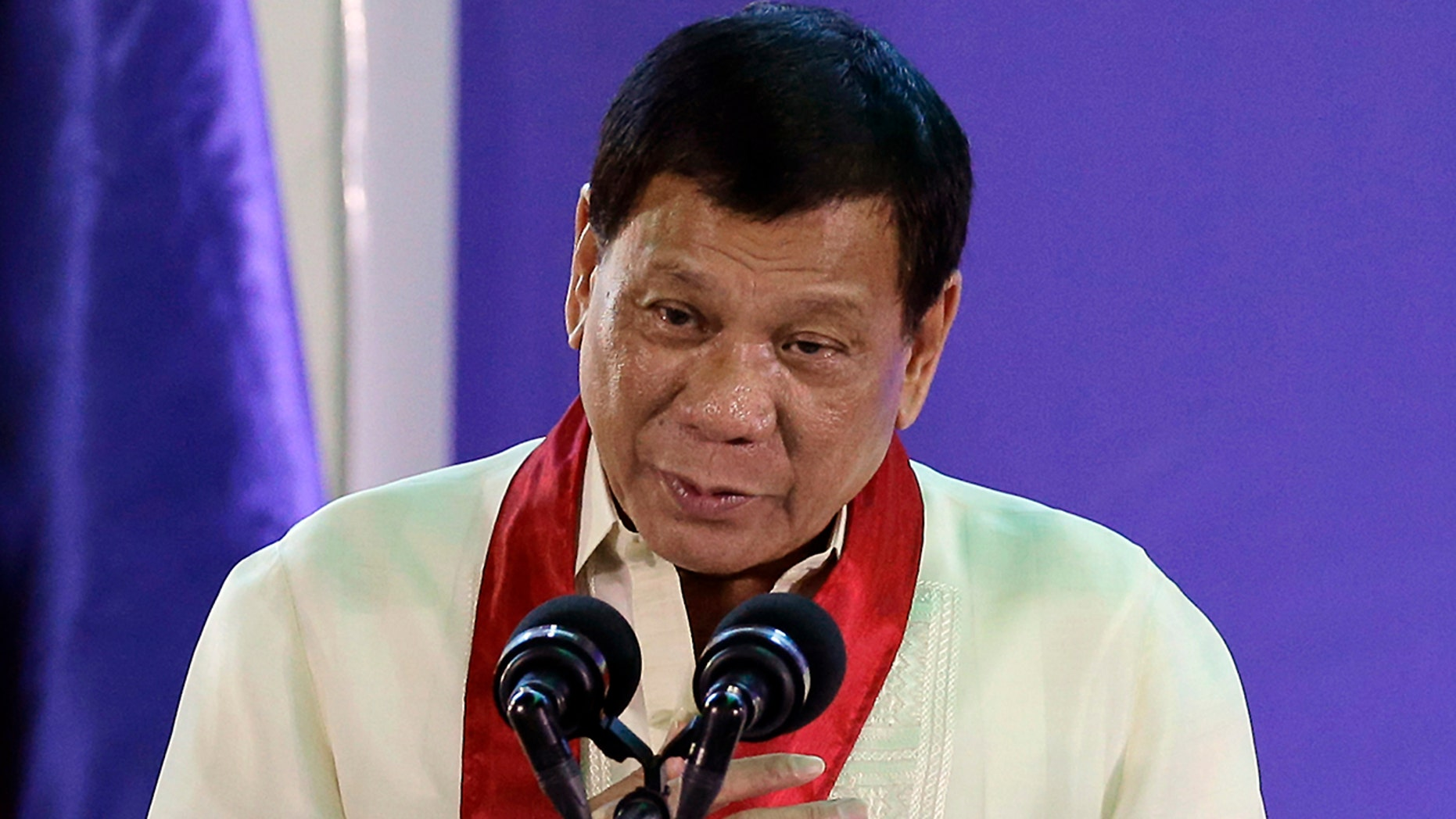 FILE - In this Aug. 2, 2017 file photo, Philippine President Rodrigo Duterte speaks during the 113th Founding Anniversary of the Bureau of Internal Revenue in metropolitan Manila. The Philippine president says he became a local millionaire at a young age due to inheritance and reiterated he has no unexplained wealth as alleged by his leading critic, who questioned his claim that he was born into an impoverished family. (AP Photo/Aaron Favila, File)