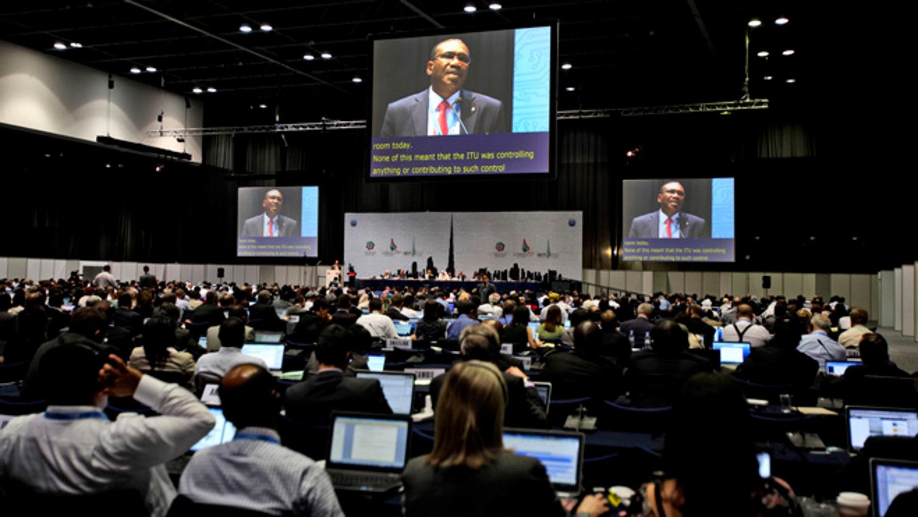 Participants listen to the speech of Hamdoun Toure, Secretary General of International Telecommunication Union, ITU, seen on screens, at the eleventh day of the World Conference on International Telecommunication in Dubai, United Arab Emirates, Monday Dec. 3, 2012.