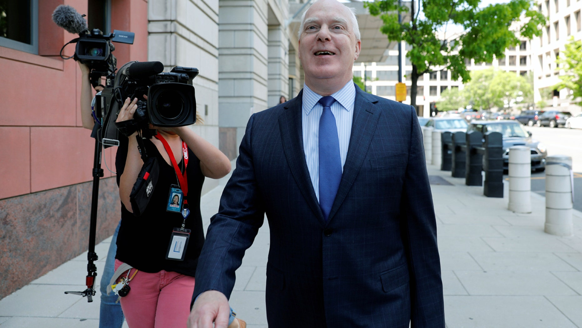 Lawyer Eric Dubelier leaves U.S. District Court in Washington last week after entering a not guilty plea on behalf of Concord Management and Consulting LLC