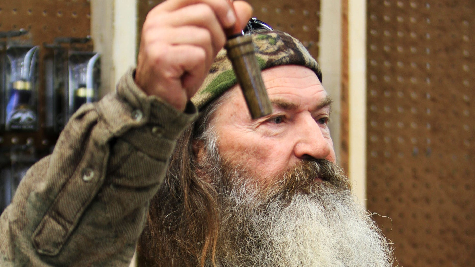 Nov. 7, 2013: Photo shows Phil Robertson, the Duck Commander, holding the 1 millionth duck call assembled for 2013 at company'ss warehouse in West Monroe, La.