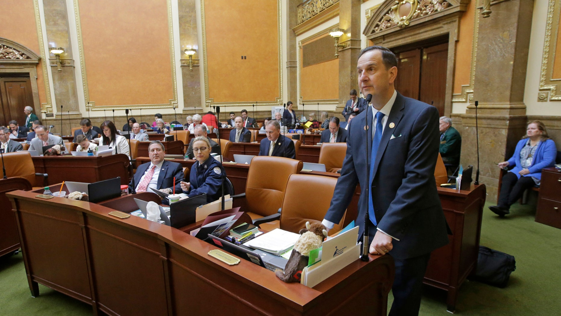 This Tuesday, Feb. 21, 2017, photo, Rep. Norm Thurston, R-Provo, speaks on the House floor, at the Utah State Capitol, in Salt Lake City.