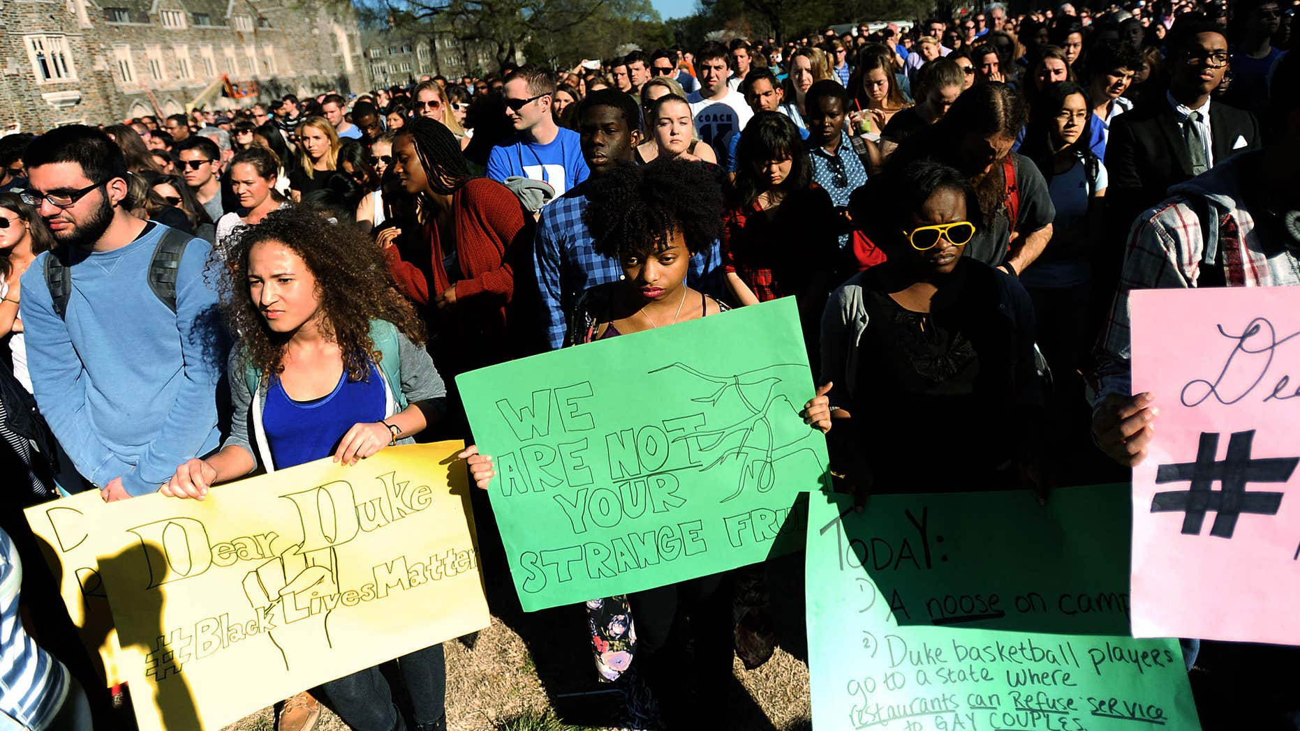April 1, 2015: Duke student from front left to right, Michaela Stith, Ashley Croker-Benn and Jasmine Roddey rally during a university-wide forum outside the Duke Chapel on campus.