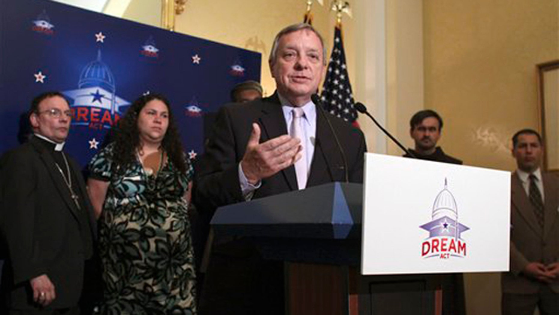 Sen. Dick Durbin, at podium, joined by religious leaders, gestures during a news conference on Capitol Hill July 12 to discuss the upcoming 'DREAM Act Sabbath.'