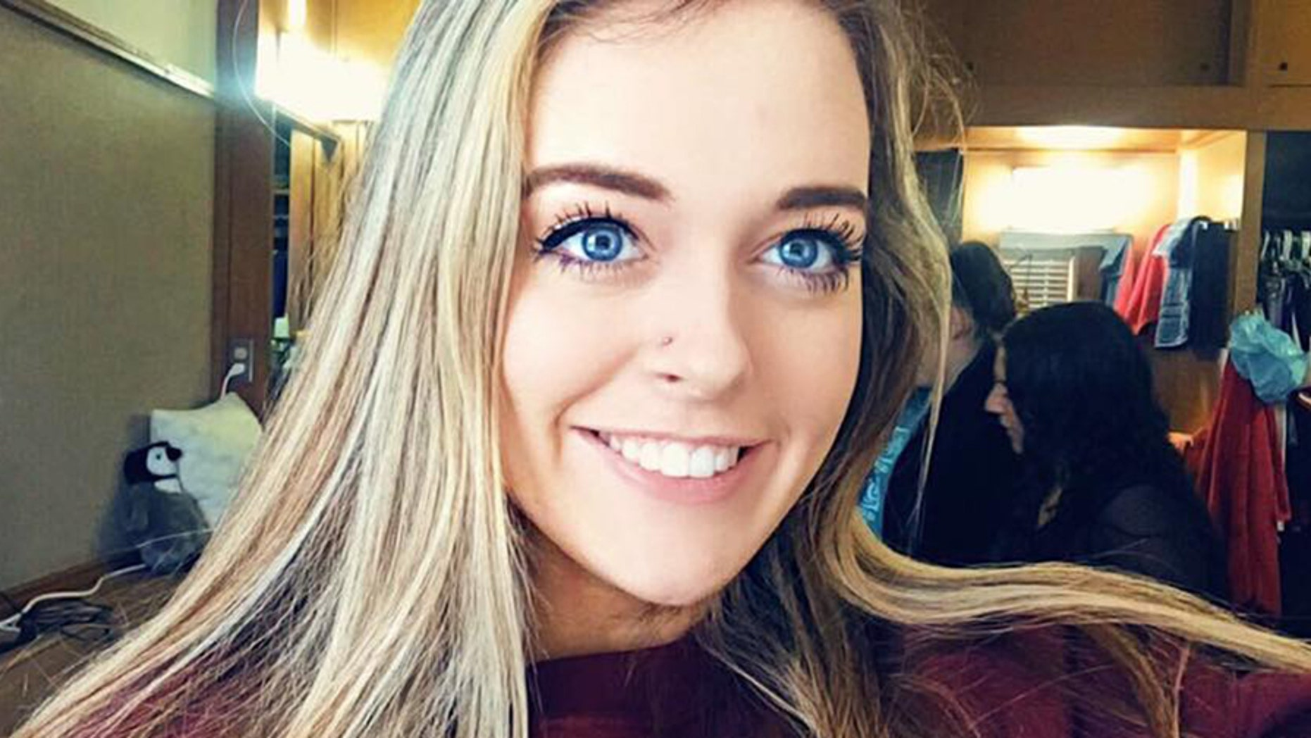 The 19-year-old college coed was pulled aside by TSA after flashing her college's salute at a traveler wearing a Texas Tech hoodie.