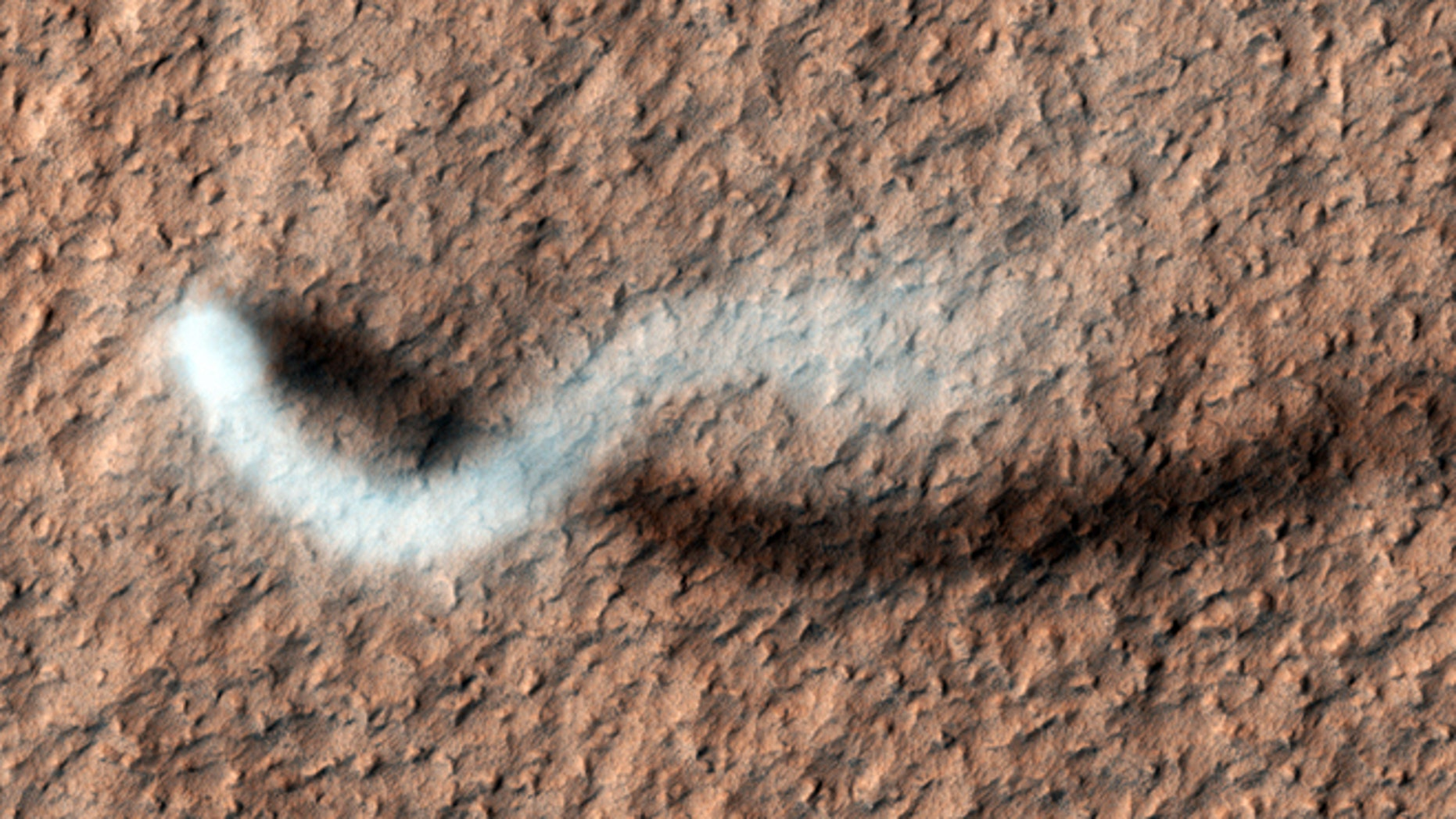 A towering dust devil casts a serpentine shadow over the Martian surface in this stunning, late springtime image captured recently by NASA. But how would it sound?