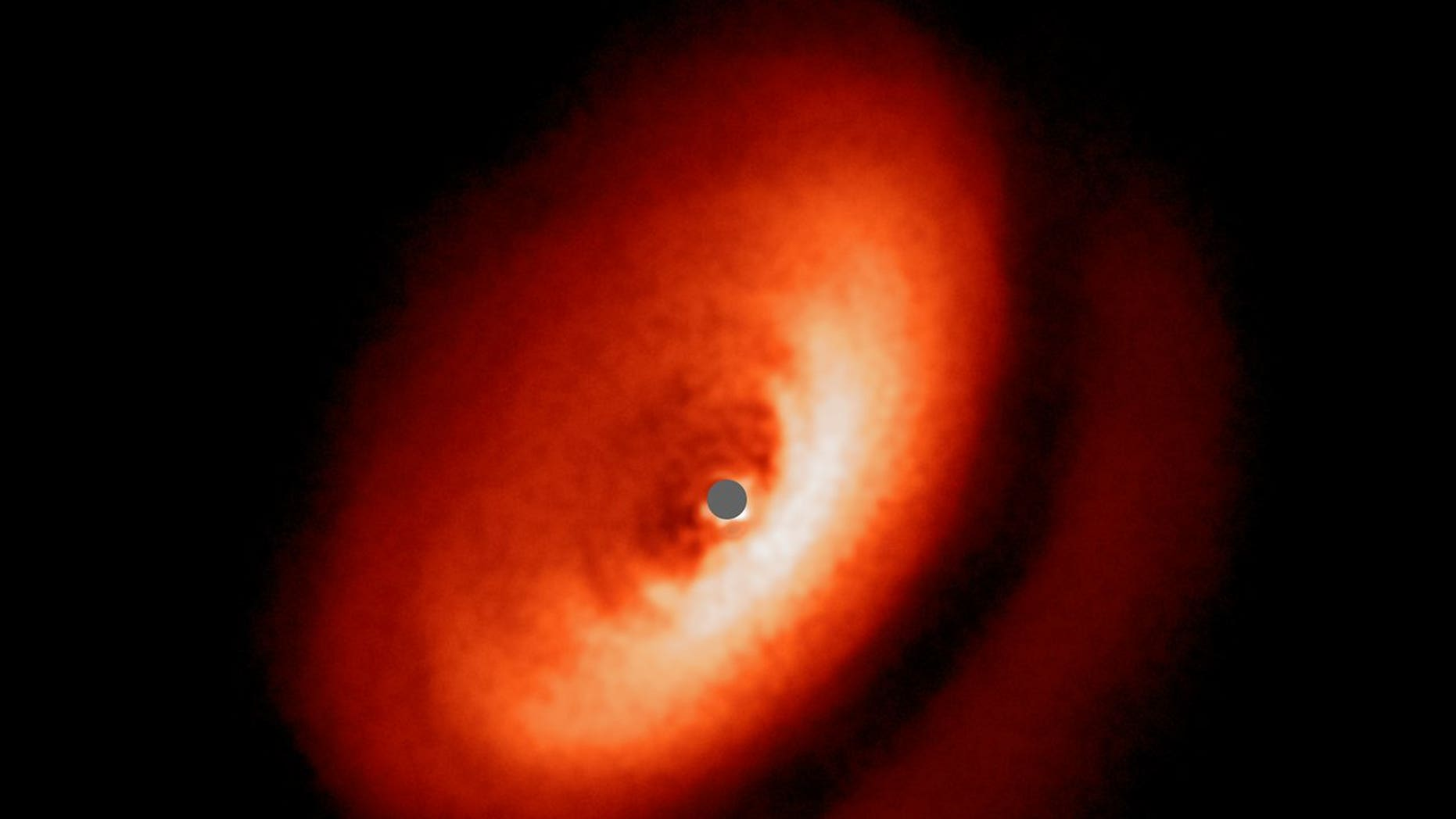An image from the Very Large Telescope's SPHERE instrument showing the dusty disk around the young star IM Lupi.