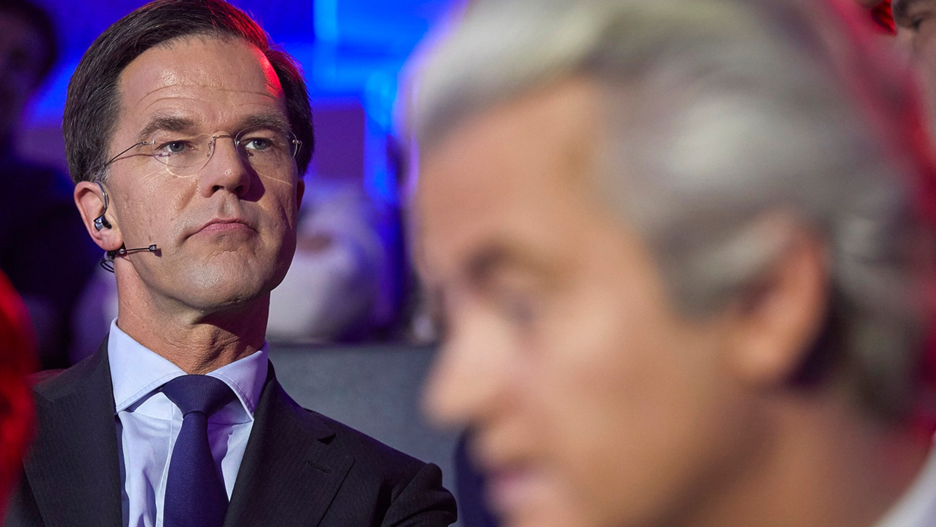 Dutch Prime Minister Mark Rutte, left, and PVV party leader Geert Wilders, right, wait to take their turn in the closing debate at parliament in The Hague, Netherlands, Tuesday, March 14, 2017.