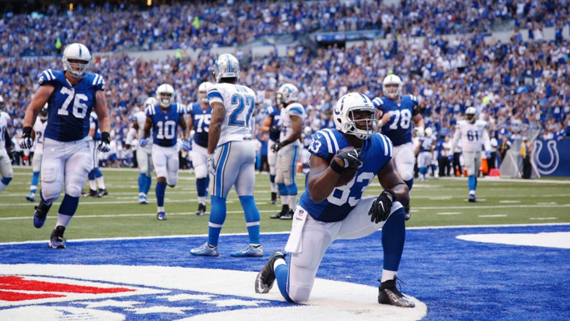 INDIANAPOLIS, IN - SEPTEMBER 11: Dwayne Allen #83 of the Indianapolis Colts reacts after a 19-yard touchdown reception against the Detroit Lions during the game at Lucas Oil Stadium on September 11, 2016 in Indianapolis, Indiana. The Lions defeated the Colts 39-35. (Photo by Joe Robbins/Getty Images)