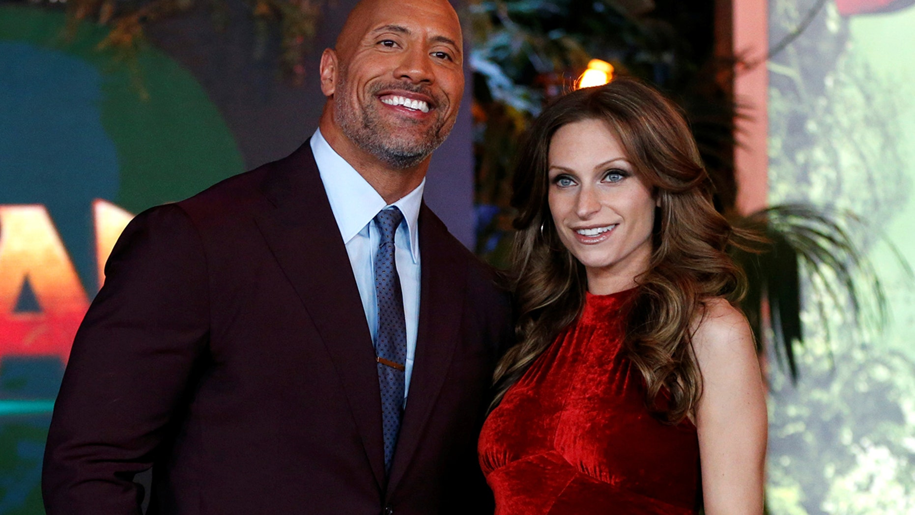 """Cast member Dwayne Johnson and Lauren Hashian pose at the premiere for """"Jumanji: Welcome to the Jungle"""" in Los Angeles, California, U.S., December 11, 2017."""